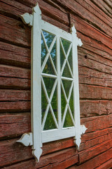 Old handmade window and red timber wall