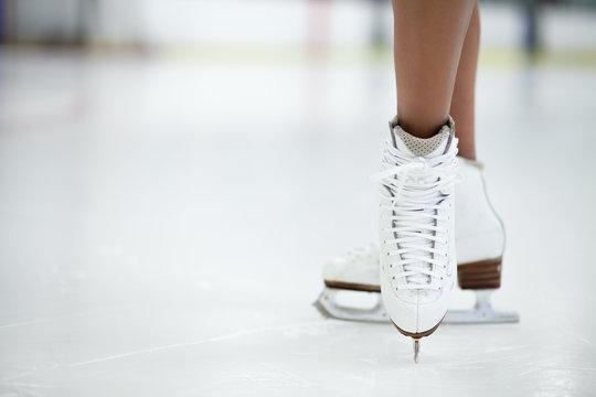 Figure Skates Close Up on Ice