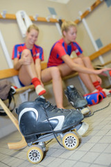 Ladies in changing room with roller scates