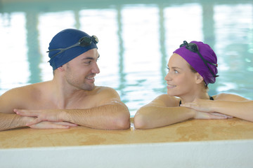 couple in the pool with swimming cap