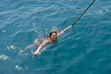 High angle view of young woman swimming in the sea.