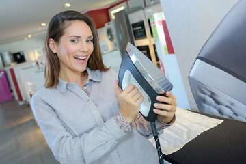 Woman holding new iron