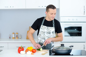 attractive man cooking in a kitchen