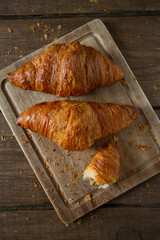 fresh croissant over wood
