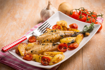 monkfish with potatoes and tomatoes, selective focus