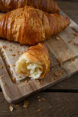 fresh croissant over wood