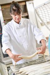 Baker preparing dough