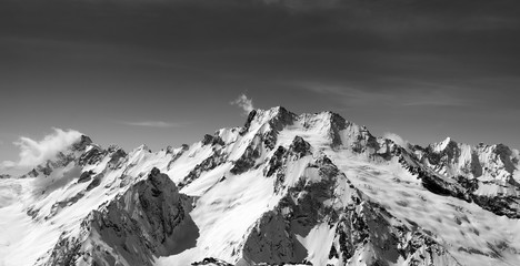 Fototapete - Black and white panoramic view of snow covered mountain peaks