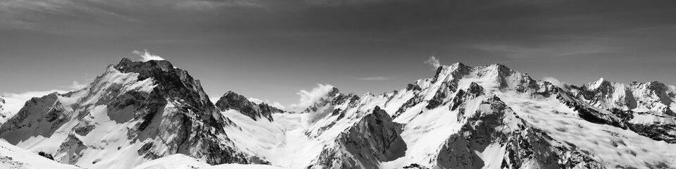 Fototapete - Black and white panoramic view of snow-capped mountain peaks