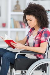 handicapped woman reading the book