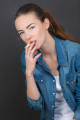 young sexy woman smoking cigarette