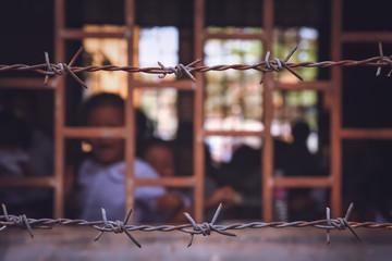 School behind barbed wires Fototapete