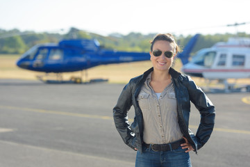 helicopter pilot posing on tarmac