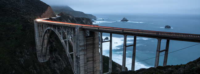 Bixby Bridge at night with car light streaks