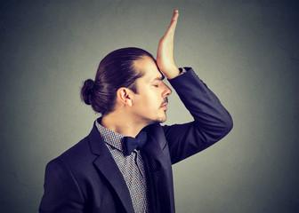 Man blaming himself in stupid behaviour