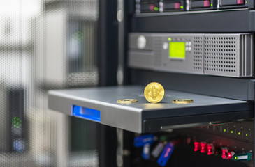 Bitcoin, litecoin ethereum on PC in the server room, golden coins, souvenirs coins, copy space. Business concept: cryptocurrency fever