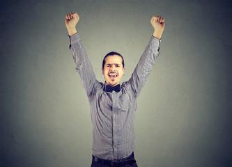 Winning man posing on gray