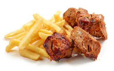 fried potatoes and pork kebab