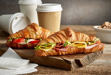 croissant sandwiches and coffee cups