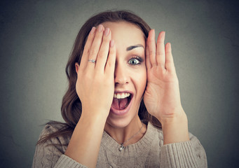 Funny woman revealing face and smiling