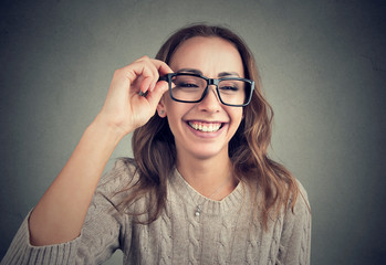 Laughing young woman in eyeglasses