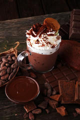 Hot chocolate or coffee with whipped cream in glass