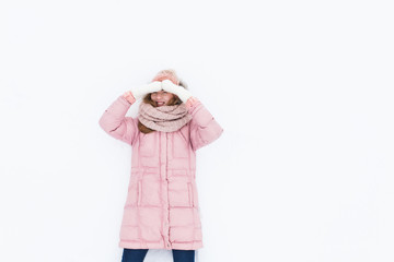 Young positive girl on white isolated background, snow field, winter morning, happy beautiful, the picture for the ad,