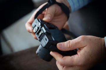 man hand holding digital camera