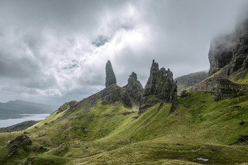 Old man of Storr on the Isle of Skye in Scotland during an overcast day with light breaking through the clouds