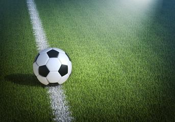 Soccer ball on the stadium field