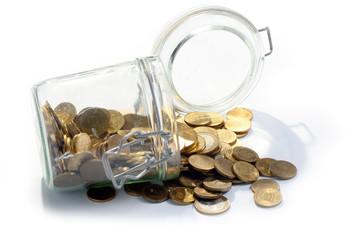 a heap of metallic Russian rubles in a glass jar