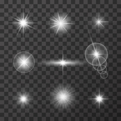 Realistic glare of light. Collection of white stars with glare on a dark transparent background. Light vector effect. Vector illustration.