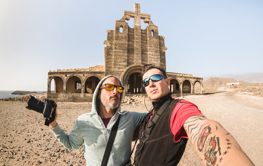 Adventurous best friends taking selfie at abandoned place in Tenerife - Wanderlust travel lifestyle enjoying moments and sharing happiness - Trip together around the world as alternative lifestyle