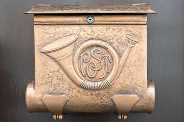 Old style white metallic mailbox.