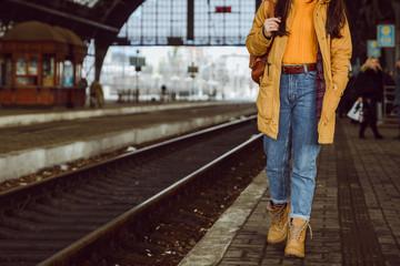 Fototapeta woman walk by railway station obraz