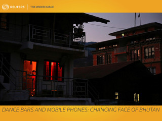 The Wider Image: Dance bars and mobile phones: changing face of Bhutan