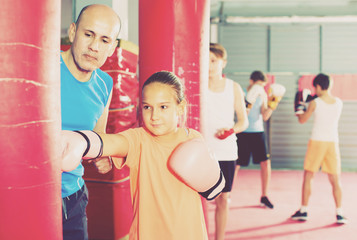Girl with boxing gloves posing in defended stance