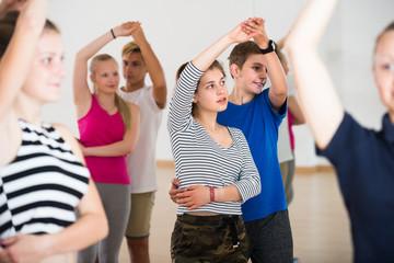 Group of teen dancing salsa in dance studio