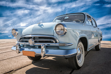 Vintage car staying at sunset.