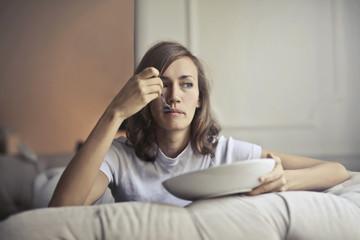 Bored girl eating