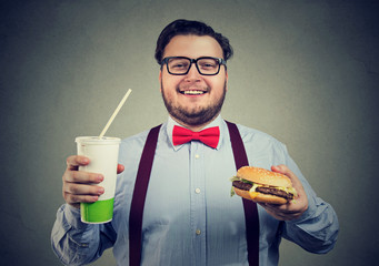 Chubby man posing with fast food