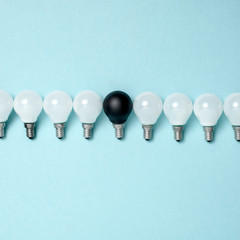 One light bulb outstanding,glowing different.business creativity idea concepts.flat lay design