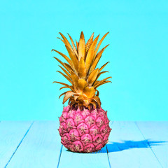 Tropical Pineapple Fruit. Bright Summer Color. Creative Minimal. Hot Summer Vibes. Pink Yellow pineapple on Sunny background. Trendy fashion Style. Pop Art