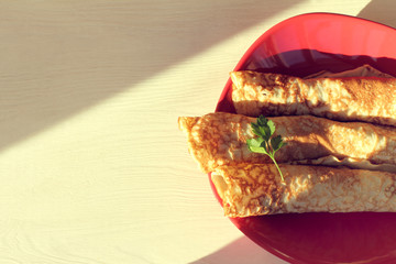 hot breakfast for sunny morning/ pancakes on red plate top view