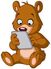 Teddy bear with tablet