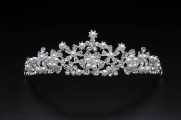 tiara with pearls isolated on a black background