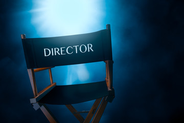 Back of a vintage director chair on a smokey background , high contrast image