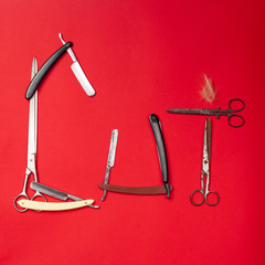 combs and hairdresser tools on red background top view