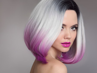 Spoed Fotobehang Kapsalon Colored Ombre hair extensions. Beauty Model Girl blonde with short bob purple hairstyle isolated on gray background. Closeup woman portrait.
