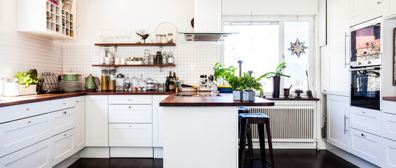 horizontal banner of a fancy kitchen interior with dark wooden floor and kitchen counter top